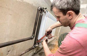 Демонтаж-радиатора-для-увеличения-сечения