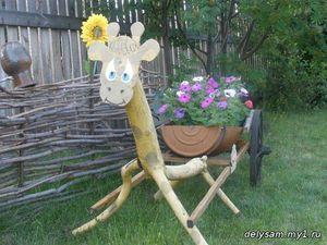 Жираф-клумба фото