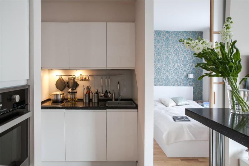 Белая кухня в квартире-студии