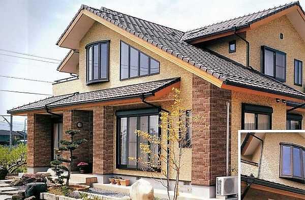 Этот дом тоже снаружи облицован фиброцементными плитами