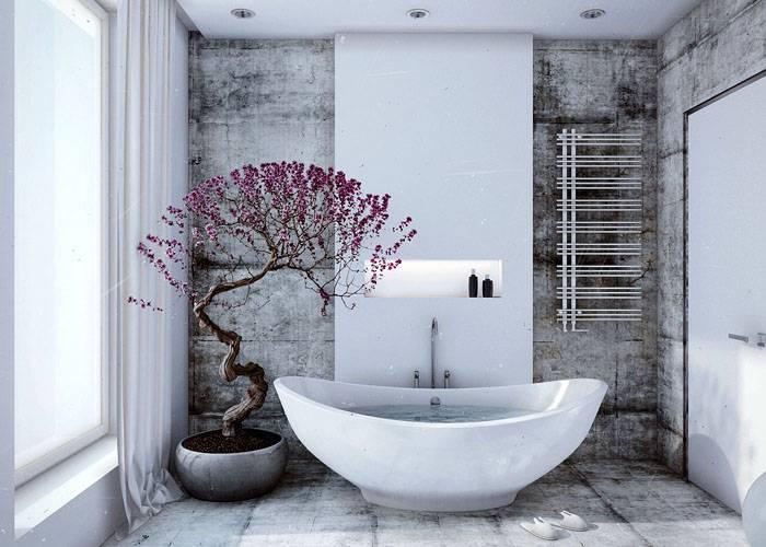 Серый бетонный фон отлично сочетается с белоснежной сантехникой и керамикой
